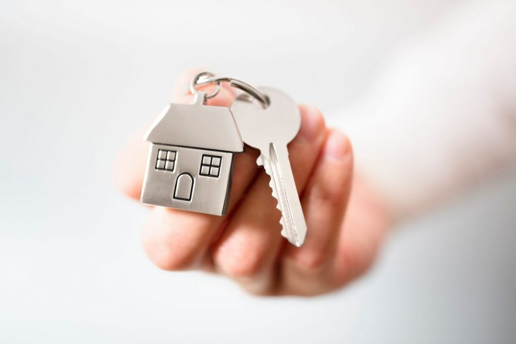 real-estate-agent-giving-house-keys-PG22LTU_tiny