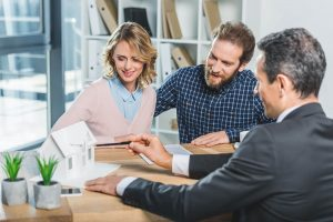 real estate agent with couple clients