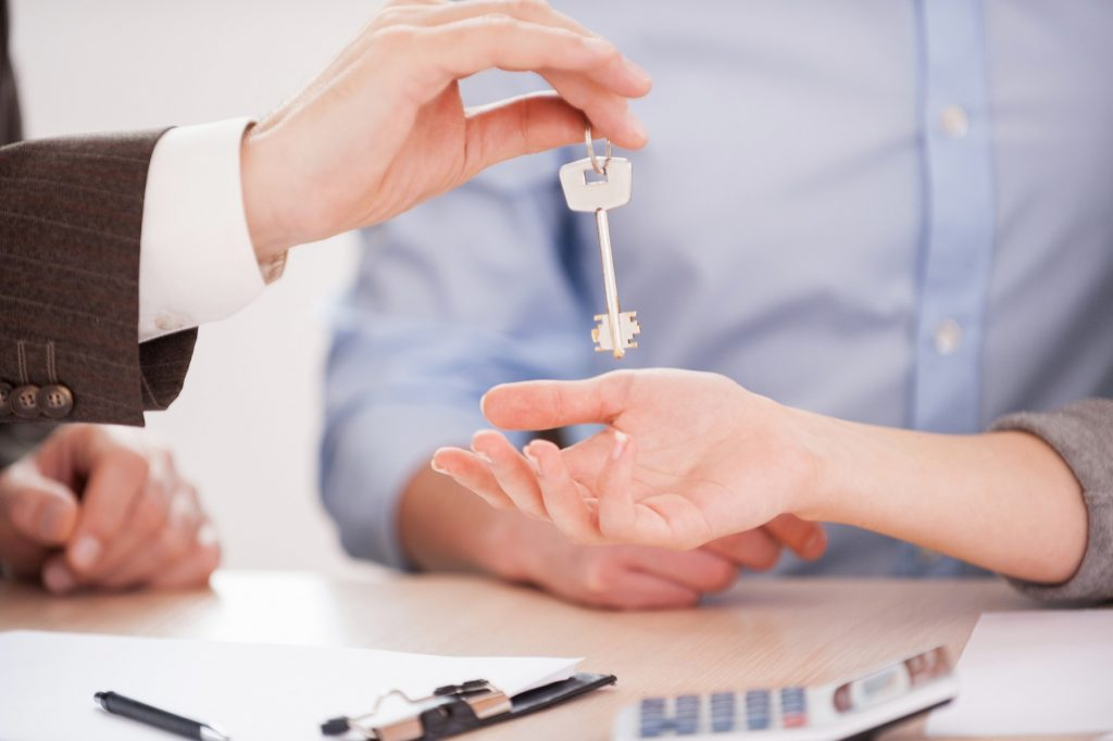 Real estate agent handing over the key